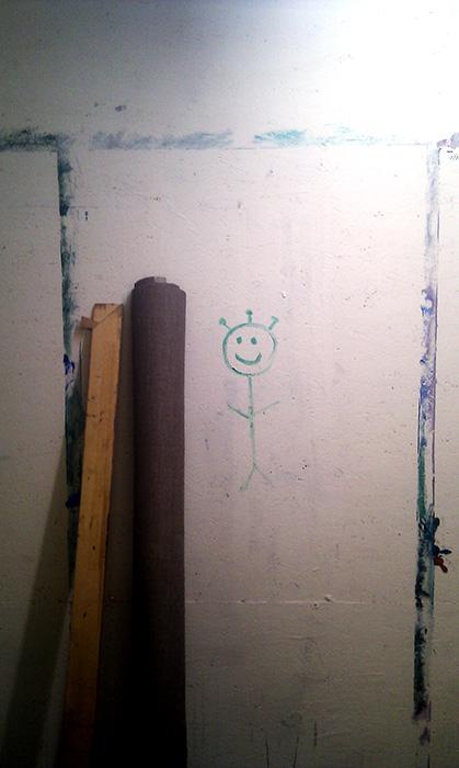 en lille smilende groen mand